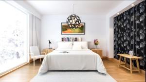 A dark wallpaper easily contrasts a light decor.